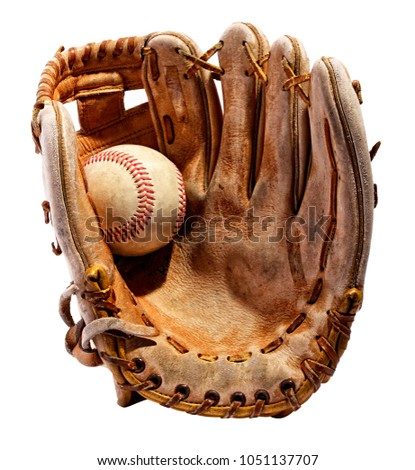 Vintage classic leather baseball glove from the palm side with the ball in it in close-up isolated on white background Royalty-Free Stock Photo #1051137707