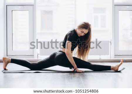 Woman doing yoga fitness exercise and stretching for relax and healthy #1051254806