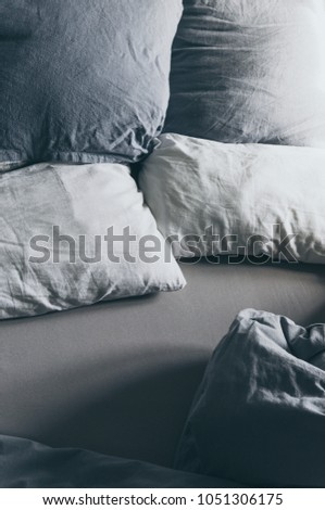 crumpled bed with sunrise lights #1051306175