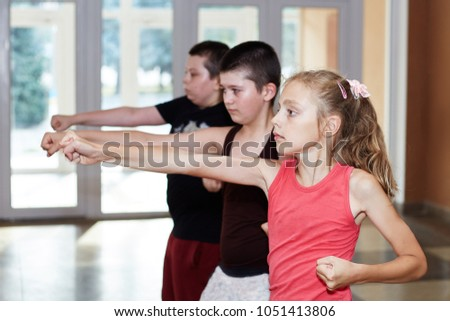 Children athletes is training punch arm #1051413806