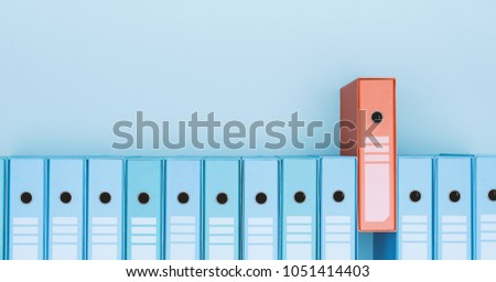 Organized archive with ring binders in a row, one is red: archive, database and search concept #1051414403