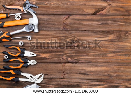Construction tools on the wooden background. #1051463900
