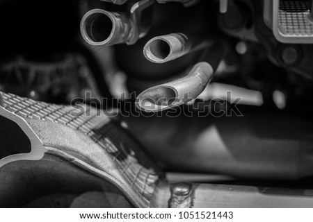The pipes in a engine of modern car . #1051521443