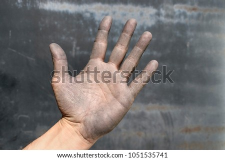 A worker's hand weathered. Palm of the hand #1051535741