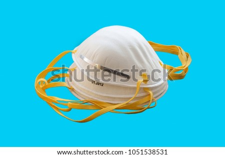 Protective face mask on a blue background  #1051538531
