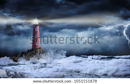 Lighthouse In Stormy Landscape - Leader And Vision Concept  Royalty-Free Stock Photo #1051551878