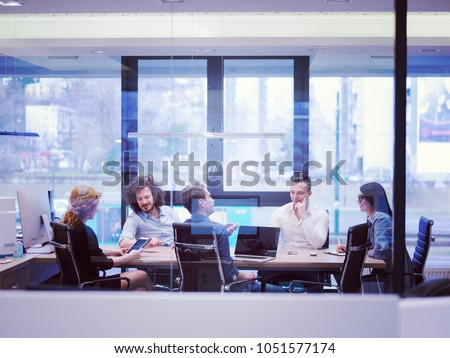 Group of a young business people discussing business plan at modern startup office building #1051577174