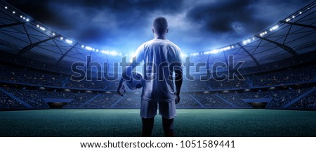 Football player in the stadium Royalty-Free Stock Photo #1051589441