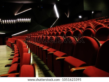 numbered theater chairs with red velvet #1051623395