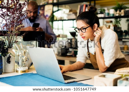 Busibess owner is using laptop #1051647749