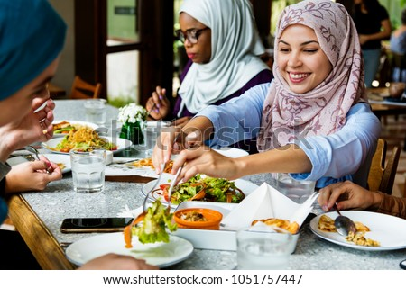 Muslim women hijab having dinner Royalty-Free Stock Photo #1051757447
