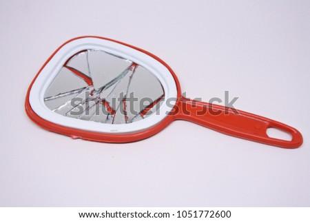 broken mirror on white background #1051772600