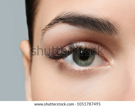 Young woman with natural eyebrows, closeup #1051787495