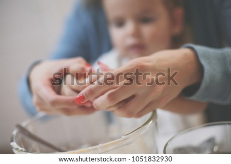 Mother and daughter in kitchen. Mother and daughter baking cookies together. Focus on hands. Close up. #1051832930