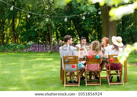 Meeting of multicultural group of friends eating dinner during a birthday party #1051856924