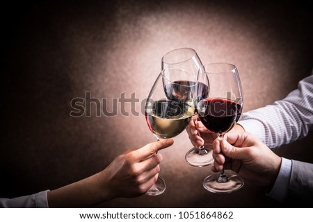 A toast with wine #1051864862