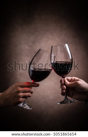 A toast with red wine #1051865654