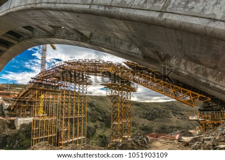 Construction of the arch of a bridge in the construction works of the ring road of Segovia in Spain #1051903109
