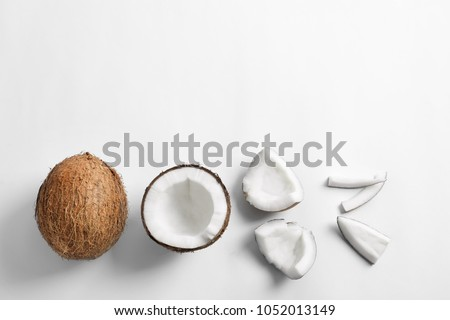 Pieces of coconut on white background, flat lay #1052013149