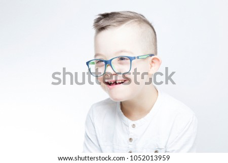 Portrait of happy child with down syndrome. #1052013959