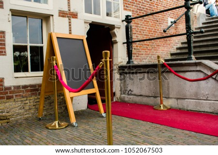 Red Carpet With A Red Fancy Fence With Gold Poles Entrance For An Old Hous And A Chalkboard Template #1052067503