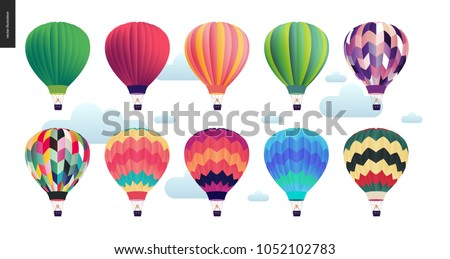Hot air balloons - set of various colored balloons in the sky with clouds Royalty-Free Stock Photo #1052102783