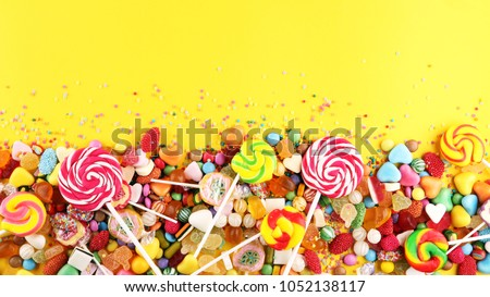 candies with jelly and sugar. colorful array of different childs sweets and treats Royalty-Free Stock Photo #1052138117