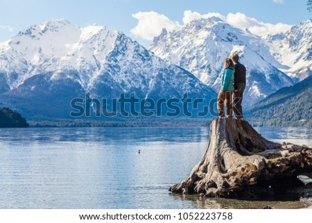 A couple admiring some very scenic views outside Bariloche, Patagonia, Argentina #1052223758