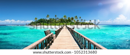 Tropical Destination - Pier For Paradise Island Royalty-Free Stock Photo #1052313680