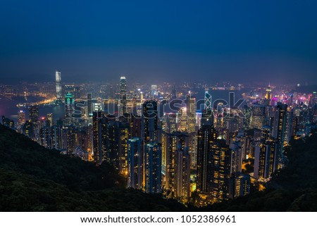 Hong Kong - 16 March 2018: Aerial night view of Hong Kong from Victoria Peak #1052386961