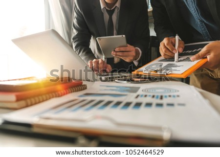 Business team present. professional investor working new start up project. Finance managers meeting.Digital tablet docking screen computer design smart phone using, in morning light #1052464529