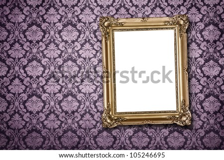 Blank gold picture frame at the ornate wall with clipping path