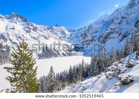 View of frozen Morskie Oko lake in winter season, Tatra Mountains, Poland #1052519465