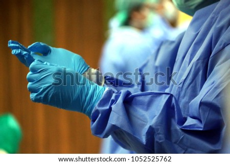 Surgery related activities for medical practitioners, The image is slightly blurry. #1052525762