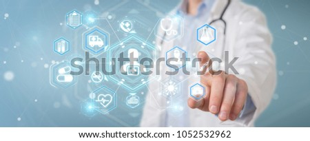Doctor on blurred background using digital medical futuristic interface 3D rendering #1052532962