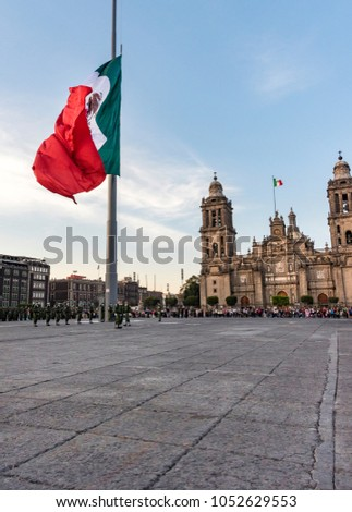 Mexico, Mexico City- 8 February 2017:  flag ceremony in the mexico city square, lowering of the flag, Soldiers in parade, backgroung Cathedral #1052629553
