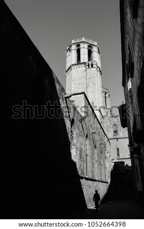 Barcelona. Silhouette of man  passing near Cathedral. Black ans white photo.