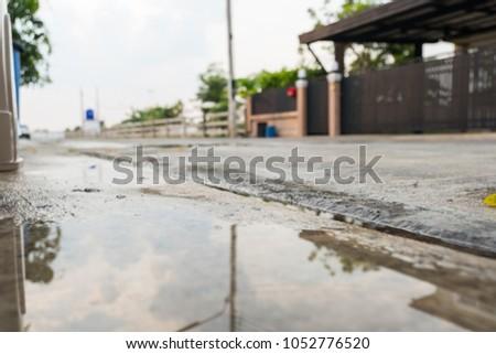 Concrete road after rain #1052776520
