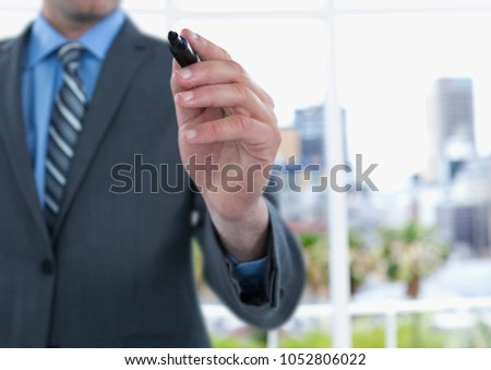 Digital composite of Midsection of businessman writing on screen #1052806022