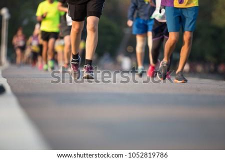 Group of people running race marathon. #1052819786