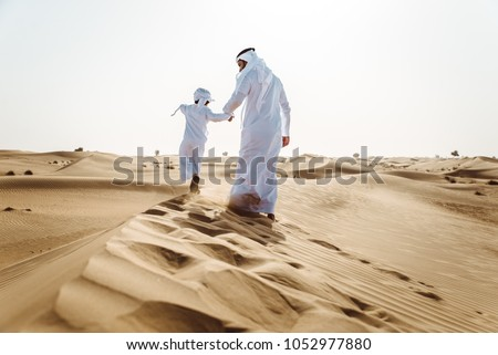 Father and son spending time in the desert #1052977880