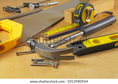 Carpenter tools – A carpenters bench with various tools  #1052980964