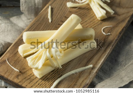Healthy Organic String Cheese For a Snack #1052985116