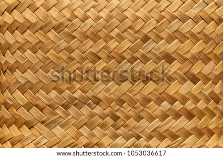 Flax weaving background: mat woven with Maori takitahi weave - New Zealand #1053036617
