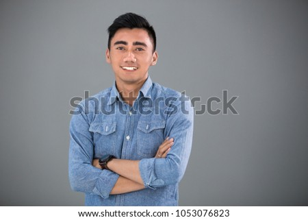 Smiling young student pose in front of the camera #1053076823