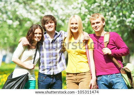 Four young students group standing in spring park outdoors #105311474