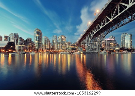 Vancouver False Creek at night with bridge and boat. #1053162299