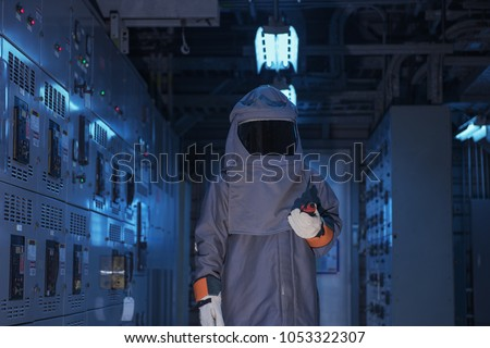 Electrical worker wearing arc flash suit  protection Royalty-Free Stock Photo #1053322307