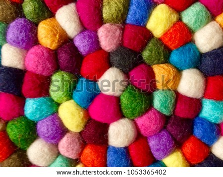 Heat Insulation made of colorful various kind of wool. The beautiful colors of fabric round mix together. #1053365402
