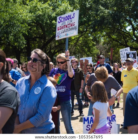 Orlando, Florida / USA - 03/24/2018 - March For Our Lives Rally demonstration protest march against gun violence Protesters marching #1053567695